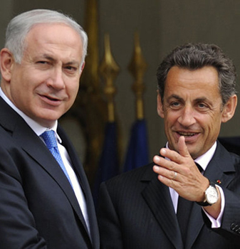 France's President Sarkozy speaks with Israel's Prime Minister Netanyahu after a lunch at the Elysee Palace in Paris