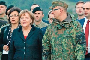 Germany's Chancellor Merkel is escorted by commander of German troops in Turkey Colonel Ellermann as she arrives at Turkish military base in Kahramanmaras