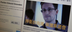 2465994_statement-by-hong-kong-online-media-supporting-snowden-displayed-alongside-white-house-website-on-computer-screen-in-hong-kong