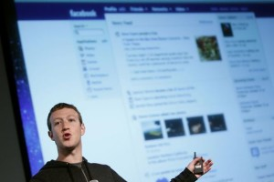 102457_facebook-ceo-zuckerberg-gestures-while-speaking-to-the-audience-during-a-media-event-at-facebook-headquarters-in-menlo-park