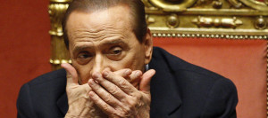 Italian Prime Minister Silvio Berlusconi reacts during a debate at the Senate in Rome