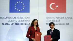 Turkey's Foreign Minister Ahmet Davutoglu and EU Home Affairs Commissioner Cecilia Malmstrom pose during the Turkey-EU Readmission Agreement Signing Ceremony in Ankara