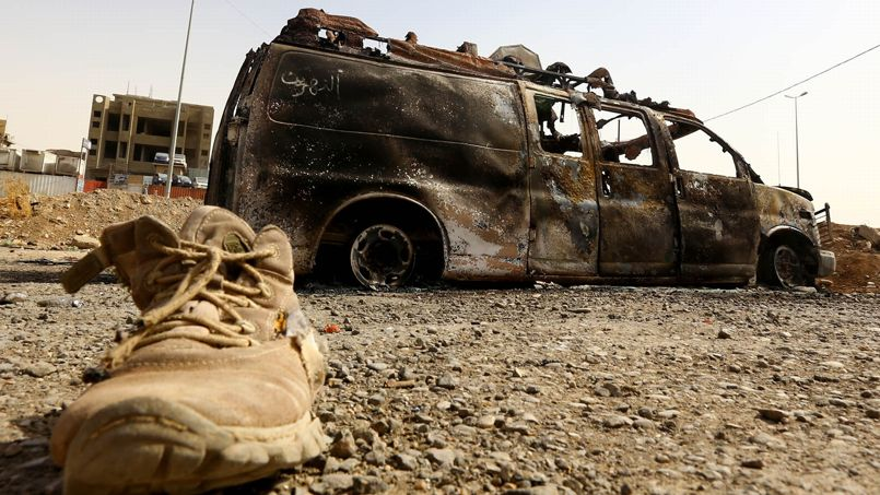 A burnt vehicle belonging to Iraqi security forces is pictured at a checkpoint in east Mosul, one day after radical Sunni Muslim insurgents seized control of the city