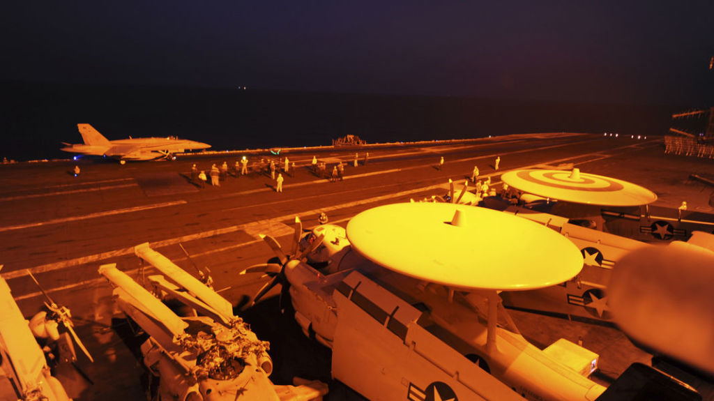 An F/A-18C Hornet prepares to launch from the flight deck of the aircraft carrier USS George H.W. Bush (CVN 77) to conduct strike missions against ISIL targets, in the Gulf