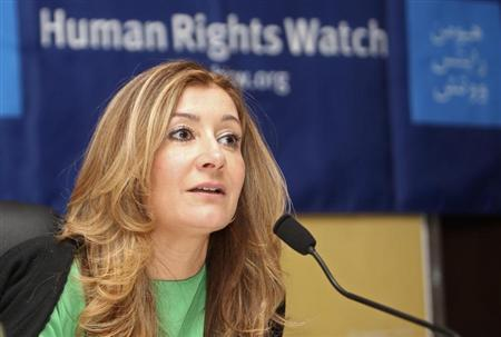 HRW Middle East director Whitson talks during a news conference in Doha